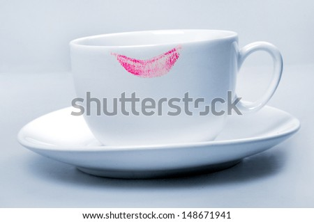 Lipstick pink on white  cup on blue background  - stock photo