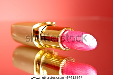 Lipstick with reflection on red background