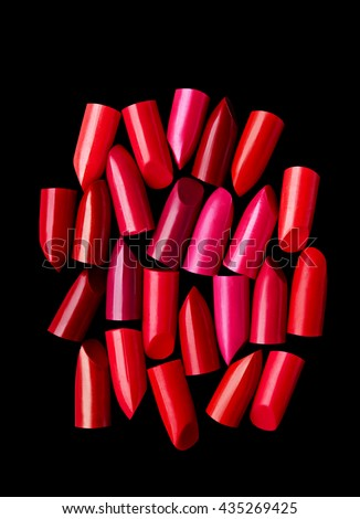 Lipsticks cut composed on black background - stock photo