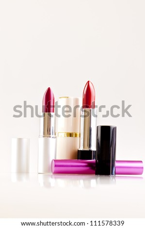 lipsticks isolated on white vertical