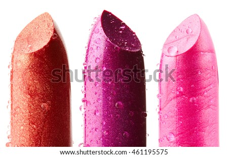 Lipsticks with drops of water isolated on white background. Set