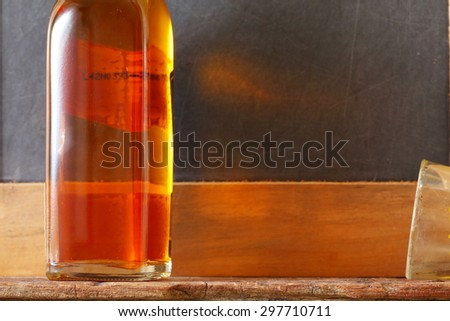 Liqour bottle and dirty shot glass represent the liquor and alcohol beverage background concept related idea. - stock photo