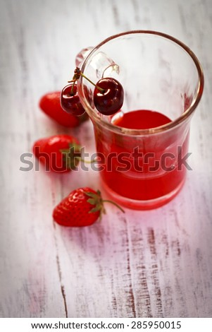 liqueur with strawberries and cherries - stock photo