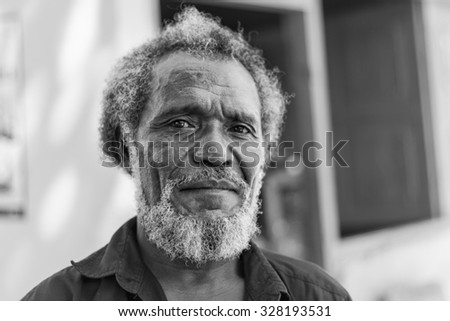 LIQUICA, EAST TIMOR - JUNE 23, 2012: Portrait of an unidentified East Timorese native leaving his house to vote on election day