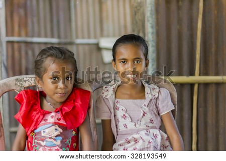 LIQUICA, EAST TIMOR - JUNE 19, 2012: Portrait of two unidentified East Timorese sisters dressed up for Sunday church visit