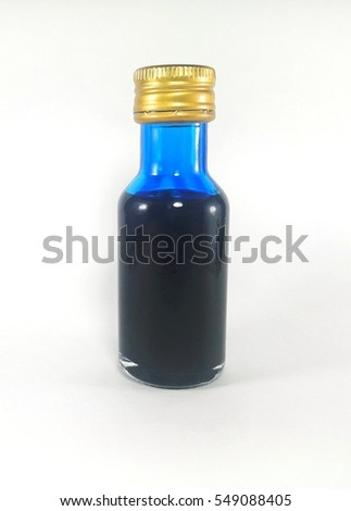 Liquid blue food color additive over white background