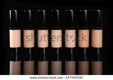Liquid Bottle Foundation Plain on Black Background - stock photo