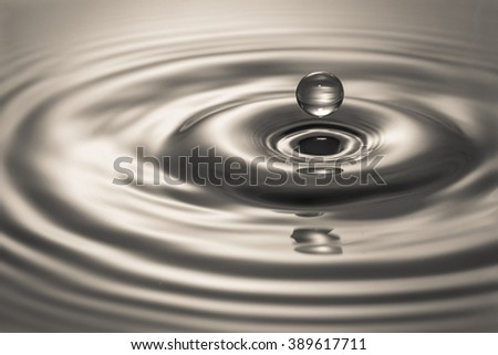 Liquid Droplet in black and white - stock photo
