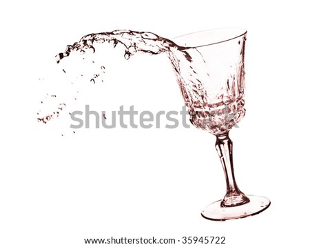 Liquid in glass with splashes - isolated on white - focus on a splash - stock photo