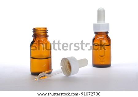 Liquid medicine in bottle on white background - stock photo