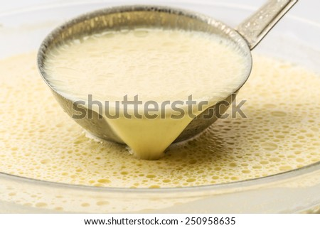 Liquid mix for pancakes is ready for baking - stock photo