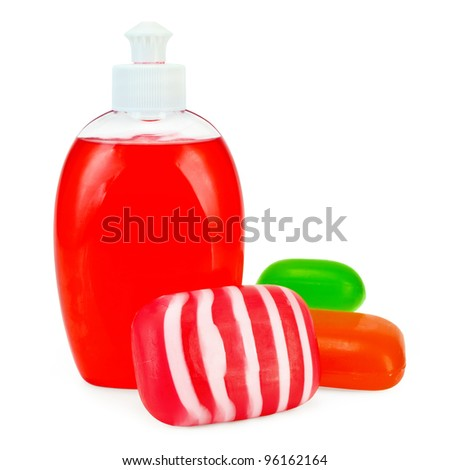 Liquid soap in a bottle, solid red, green and striped soaps isolated on white background