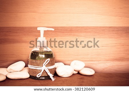 liquid soap with surface of wood background