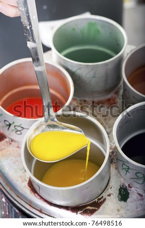 Liquid wax colors for candle production - stock photo