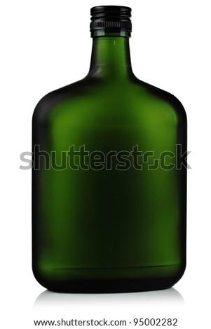 Liquor in the green glass bottles. - stock photo