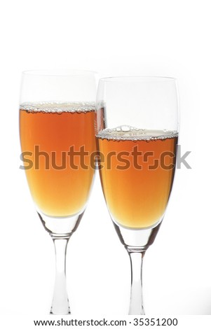 liquor in two champagne glasses