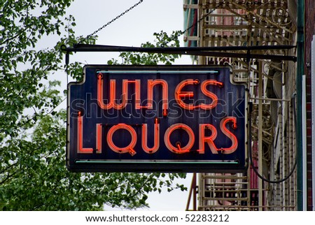 Liquor store neon sign - stock photo