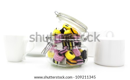 Liquorice allsort sweets in storeage in modern white kitchen set - stock photo