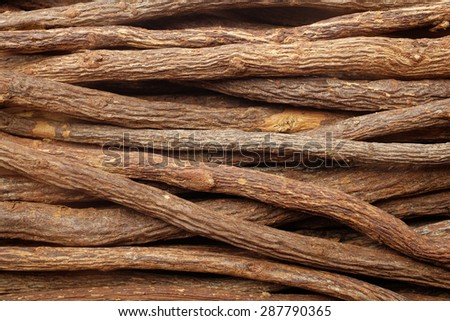 Liquorice root pieces as an abstract background texture - stock photo