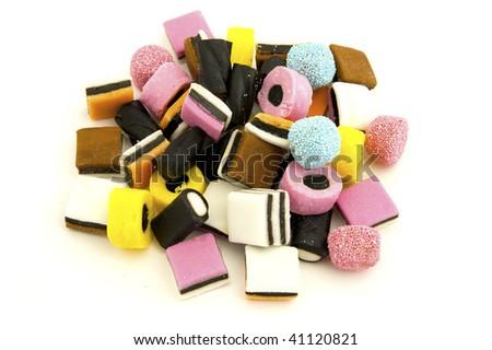 Liquorice sweets against white background - stock photo