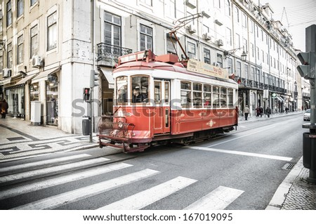 LISBOA, PORTUGAL - NOVEMBER 28: Traditional yellow tram/funicular on November 28, 2013 in Lisbon, Portugal. Carris is a public transportation company operates Lisbon's buses, trams, and funiculars.