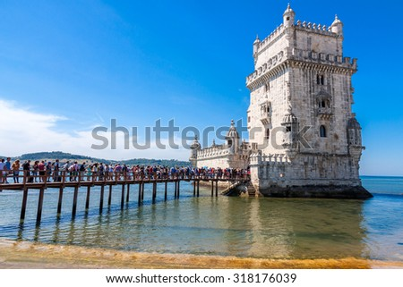 LISBON -AUGUST 8: Tourist queue at  Belem Tower  on August 8, 2015  in Lisbon, Portugal. The Belem Tower is one of the major tourist attractions in Lisbon. - stock photo