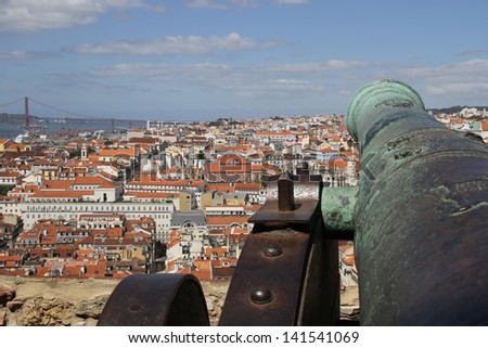 Lisbon city, seen from Saint George's Castle, seen over an old canon - stock photo