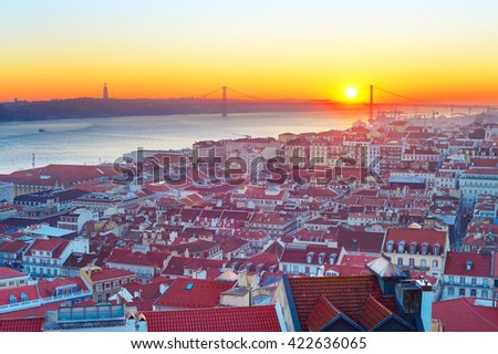 Lisbon cityscape with the sun in the sky at sunset. Portugal
