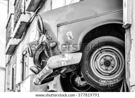 LISBON - FEBRUARY 15: Vintage car front hanging on building facade in Black and white in Lisbon, Portugal on February 15, 2016