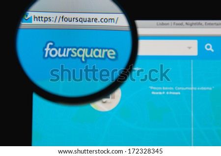 LISBON - JANUARY 20, 2014: Photo of Foursquare homepage on a monitor screen through a magnifying glass. - stock photo