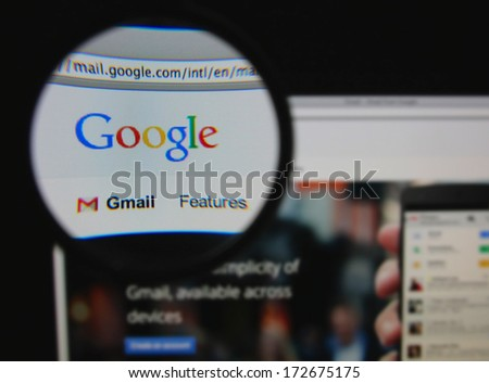 LISBON - JANUARY 22, 2014: Photo of Google mail homepage on a monitor screen through a magnifying glass. - stock photo