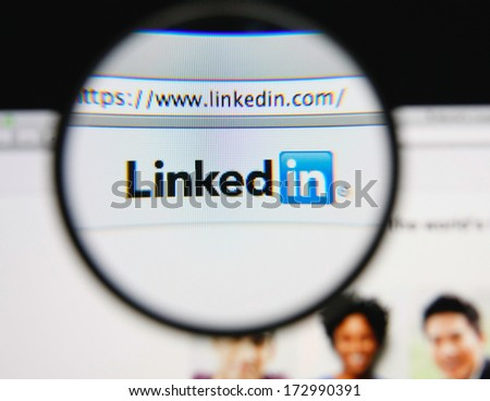 LISBON - JANUARY 24, 2014: Photo of LinkedIn homepage on a monitor screen through a magnifying glass. - stock photo
