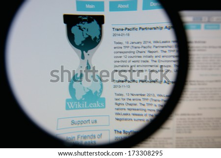 LISBON - JANUARY 27, 2014: Photo of Wikileaks homepage on a monitor screen through a magnifying glass. - stock photo