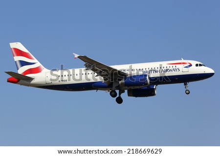LISBON - JULY 20:  A British Airways Airbus A320 on approach on July 20, 2013 in Lisbon. British Airways is the flag carrier airline of the United Kingdom with its main hub at London Heathrow Airport. - stock photo