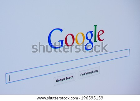 LISBON - JUNE 4, 2014: Photo of Google homepage on a monitor screen. - stock photo