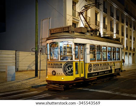 LISBON-NOVEMBER 09, 2015: A typical streetcar (trolley)at night in Lisbon, Portugal. Although Lisbon has a modern fleet of trams, the old small streetcars remain one of the main tourists attraction - stock photo