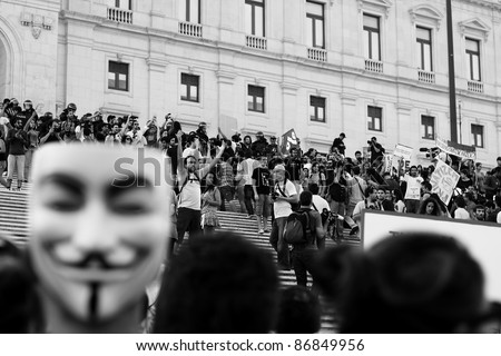 "LISBON - OCTOBER 15: Portuguese protesters participating on the global ""Occupy"" protests knock down police barriers and take the parliament marble staircase, on October 15 2011 in Lisbon, Portugal. - stock photo"