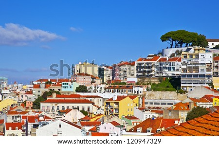 Lisbon panorama, Portugal. Buildings, roofs, churches at blue sky - stock photo