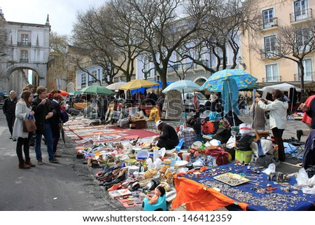 LISBON,PORTUGAL APRIL6,2013: Feira da ladra, a flea market held twice weekly attracting locals and tourists, in Alfama, Lisbon, Portugal on April, 6 2013