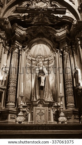 LISBON, PORTUGAL - APRIL 22, 2015: Statue of Virgin Mary in Church of Jeronimos Monastery. This monastery is one of the most prominent examples of the Portuguese Gothic Manueline style. - stock photo