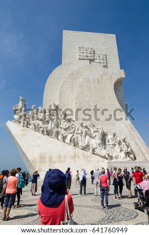 LISBON, PORTUGAL - APRIL 24: Tourists looking at the discovery monument in the Belem district in Lisbon, Portugal on April 24, 2017
