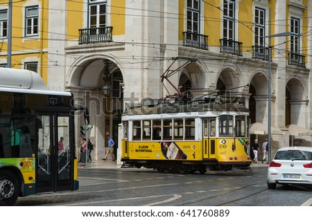LISBON, PORTUGAL - APRIL 25: Traditional tram by the square Praca do Comercio in Lisbon, Portugal on April 25, 2017
