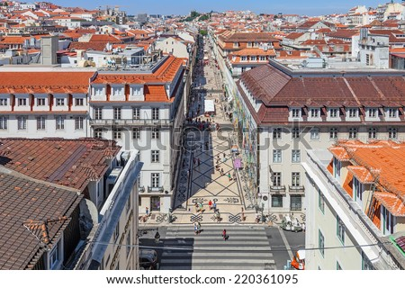 Lisbon, Portugal. August 31, 2014: Aerial view of the Augusta Street and the Downtown District, known as Baixa. The most cosmopolitan street of the city is permanently full with Lisboans and tourists - stock photo