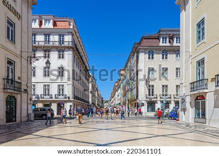 Lisbon, Portugal. August 31, 2014: Augusta Street in the Downtown District, known as Baixa. Considered as the most cosmopolitan street of the capital, is permanently filled with Lisboans and tourists - stock photo