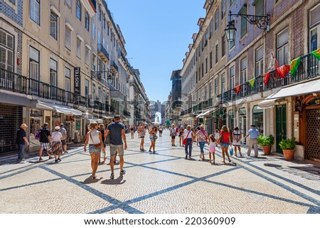 Lisbon, Portugal. August 31, 2014: Augusta Street with the Triumphal Arch seen at the end of it connecting the most famous Lisbon street to Terreiro do Paco Square aka Praca do Comercio. - stock photo
