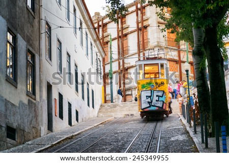 LISBON, PORTUGAL - AUGUST 15, 2014: The Gloria Funicular in Lisbon. In 2002 it was designated a National Monument in Portugal. It is a popular tourist attraction of Europe. - stock photo