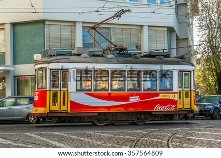 LISBON, PORTUGAL - DECEMBER 26, 2015: Famous Old trams on street of Lisbon. On 30 August 1901, Lisbon's first electric tramway commenced operations to replace horse-drawn carriages.