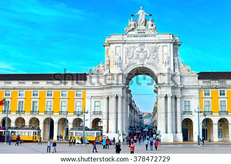 LISBON, PORTUGAL - DECEMBER 12, 2014: People walking at Rua Augusta Arch on the Commerce Square - tourist attraction in Lisbon. - stock photo