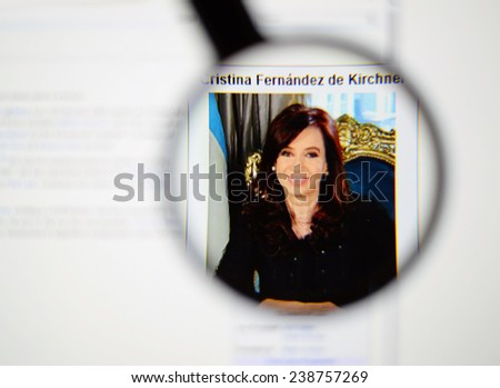 LISBON, PORTUGAL - DECEMBER 16, 2014: Photo of Wikipedia article page about Cristina Fernandez de Kirchner on a monitor screen through a magnifying glass.    - stock photo