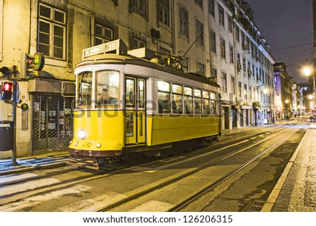 LISBON, PORTUGAL - DECEMBER 29: Traditional yellow tram downtown Lisbon by night on December 29, 2008. Trams are used by everyone and also keep the traditional style of the historic center of Lisbon.